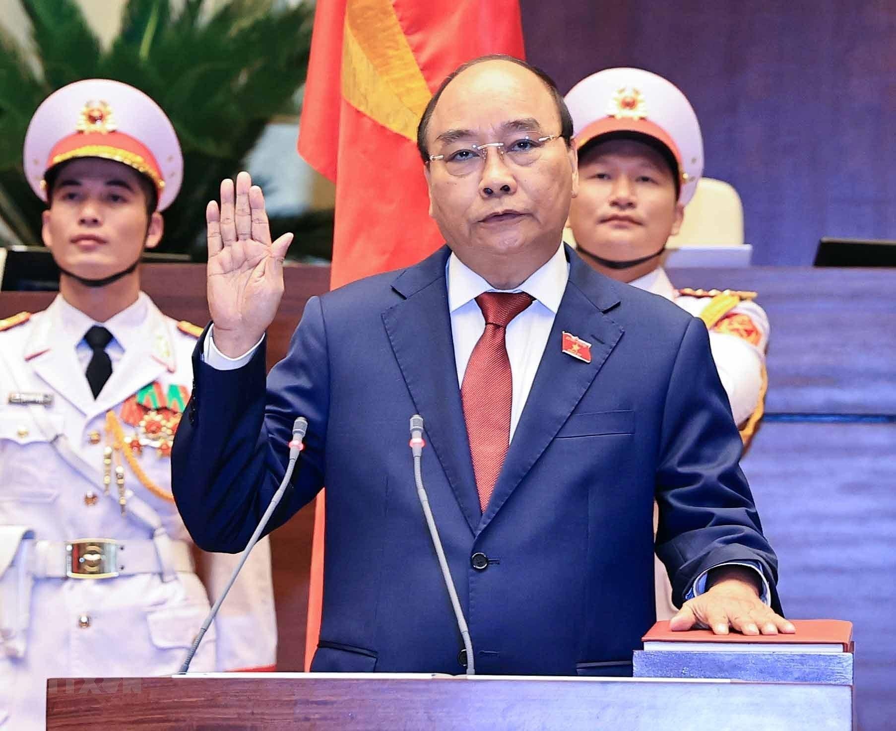 [Photo] Ong Nguyen Xuan Phuc nham chuc Chu tich nuoc hinh anh 4
