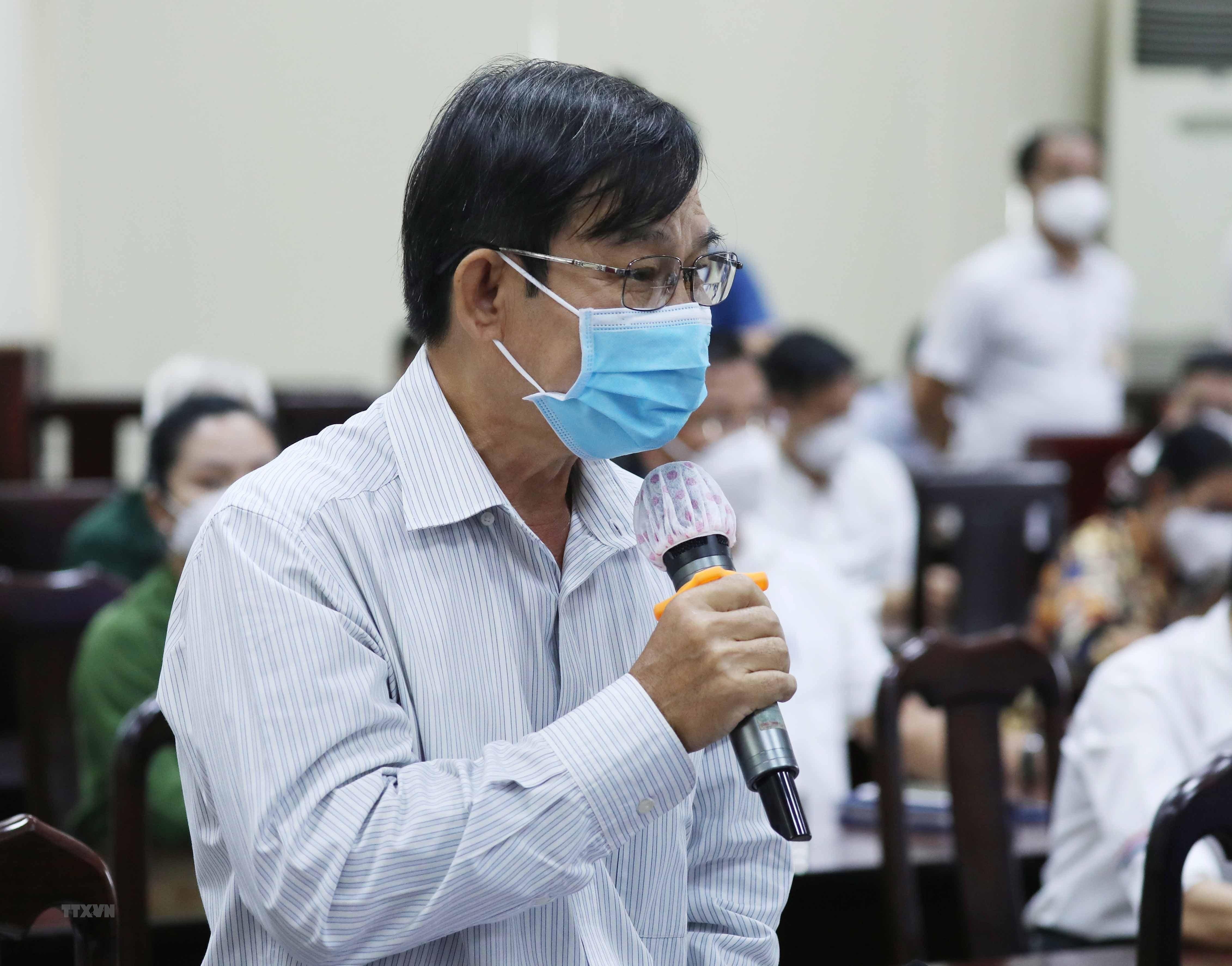 [Photo] Chu tich nuoc Nguyen Xuan Phuc tiep xuc cu tri huyen Hoc Mon hinh anh 4