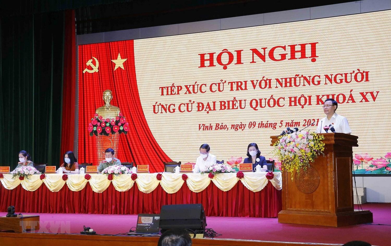 Chu tich Quoc hoi Vuong Dinh Hue tiep xuc cu tri thanh pho Hai Phong hinh anh 7
