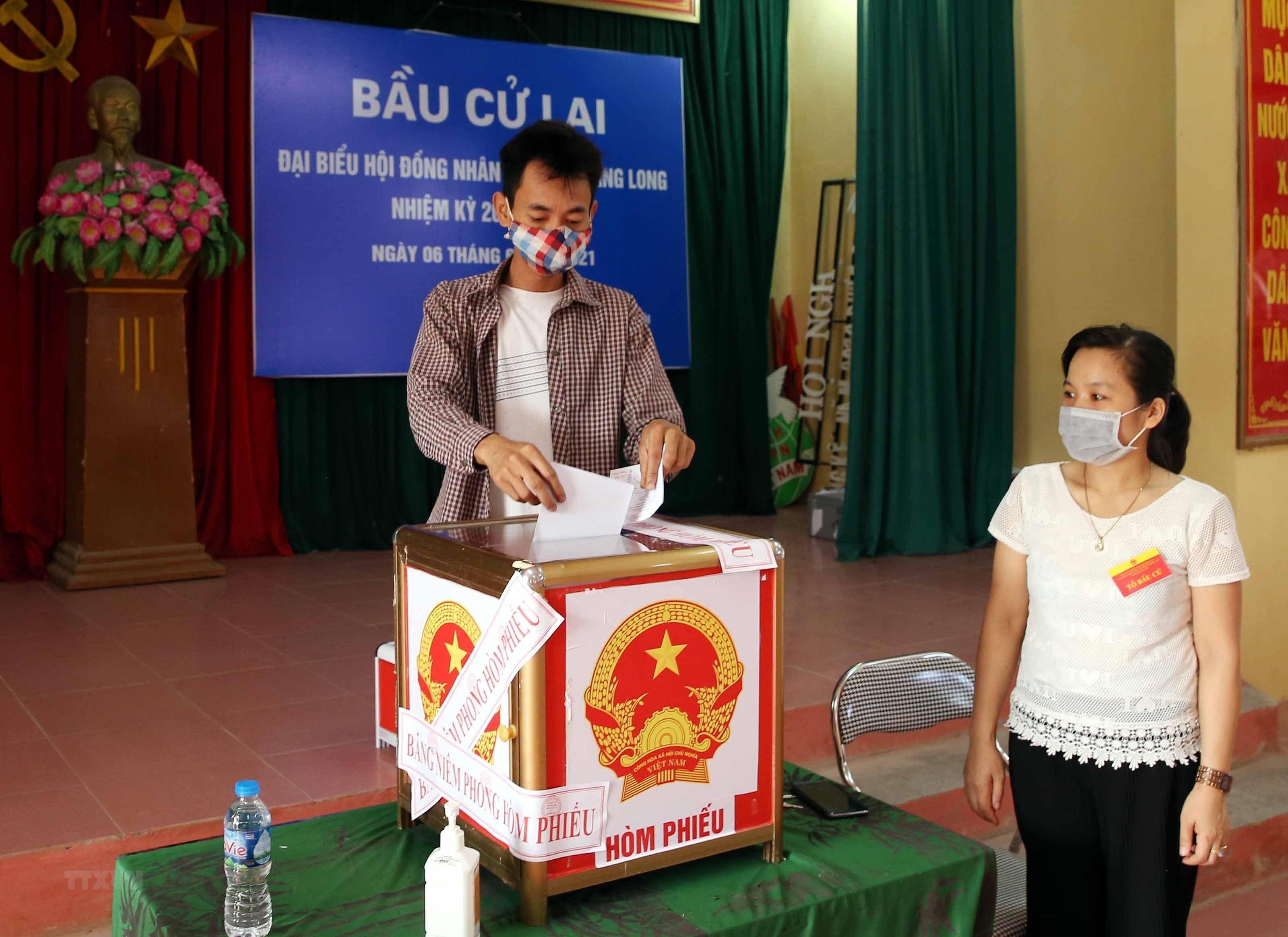 Ha Noi to chuc bau cu lai tai 2 don vi Hoi dong Nhan dan cap xa hinh anh 10